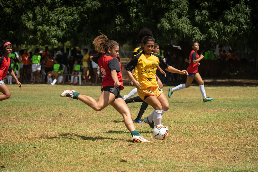 Two girls playing in a football tournament in Brazil as part of a Plan International programme