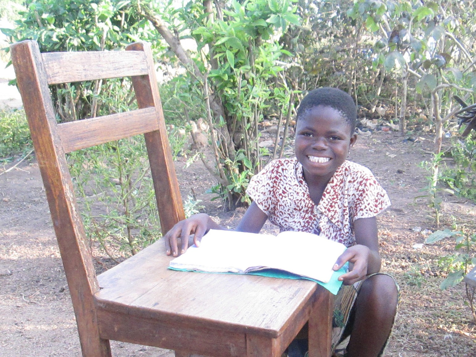 Child trafficking: Cherita doing homework and studying her lessons