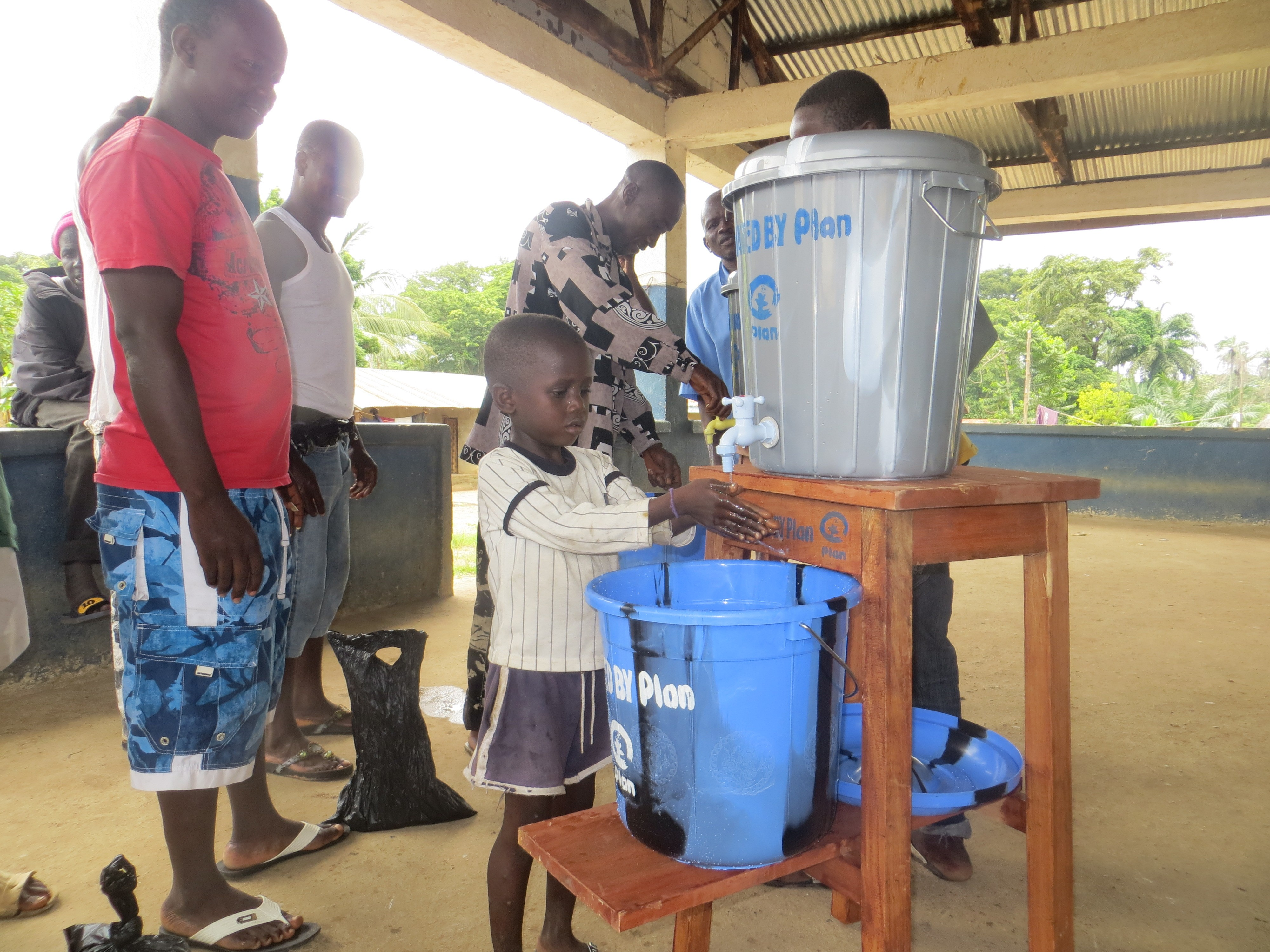 child washes hands to protect from Ebola