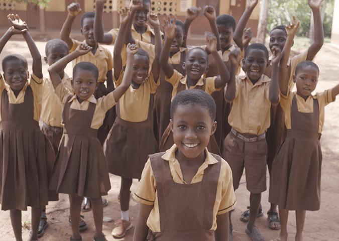 Children waving, Ghana