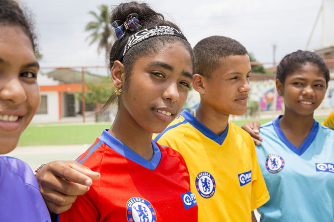 A group of young people in football kits