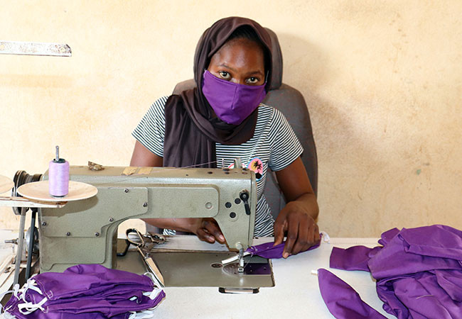 Koumba sews masks to protect her community from the spread of coronavirus