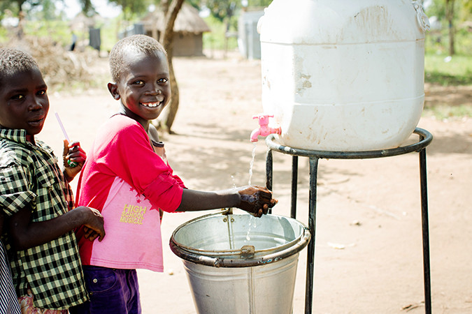 Photo of a girl washing her hands