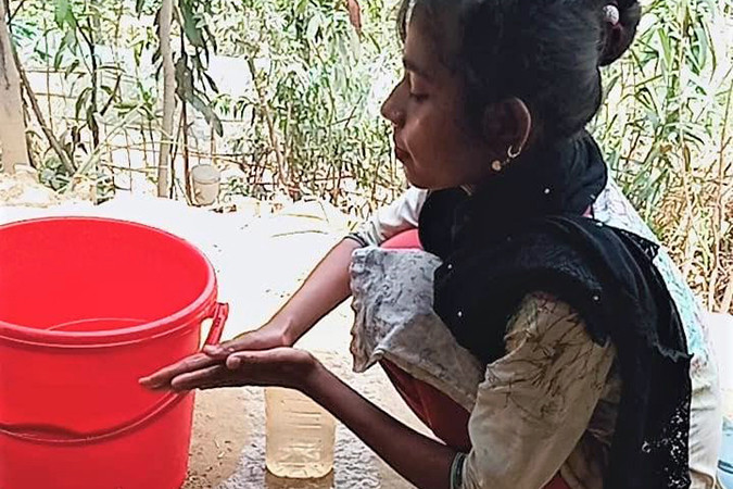 A girl washes her hands