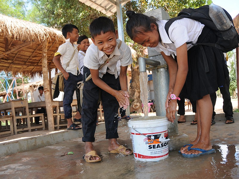 school children washing clean water