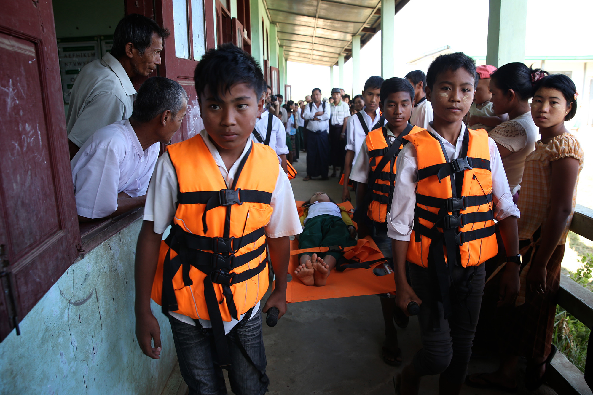 School children practice their search and rescue skills to prepare for disasters