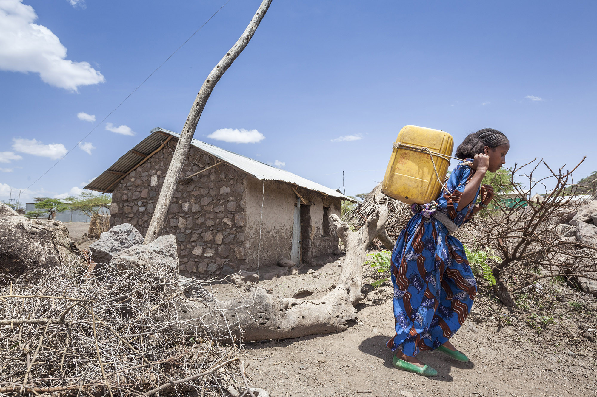 Sheshig, 13, lives in a town outside Lalibela, Ethiopia. Over the past few years, the El Nino-induced drought has had a major impact on her education, as she's often had to fetch water rather than go to school