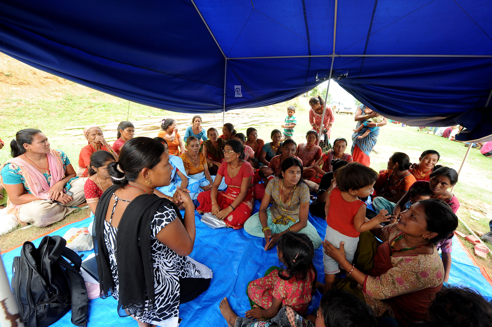 Women and children gather in a communal feeding group after the Nepal Earthquake