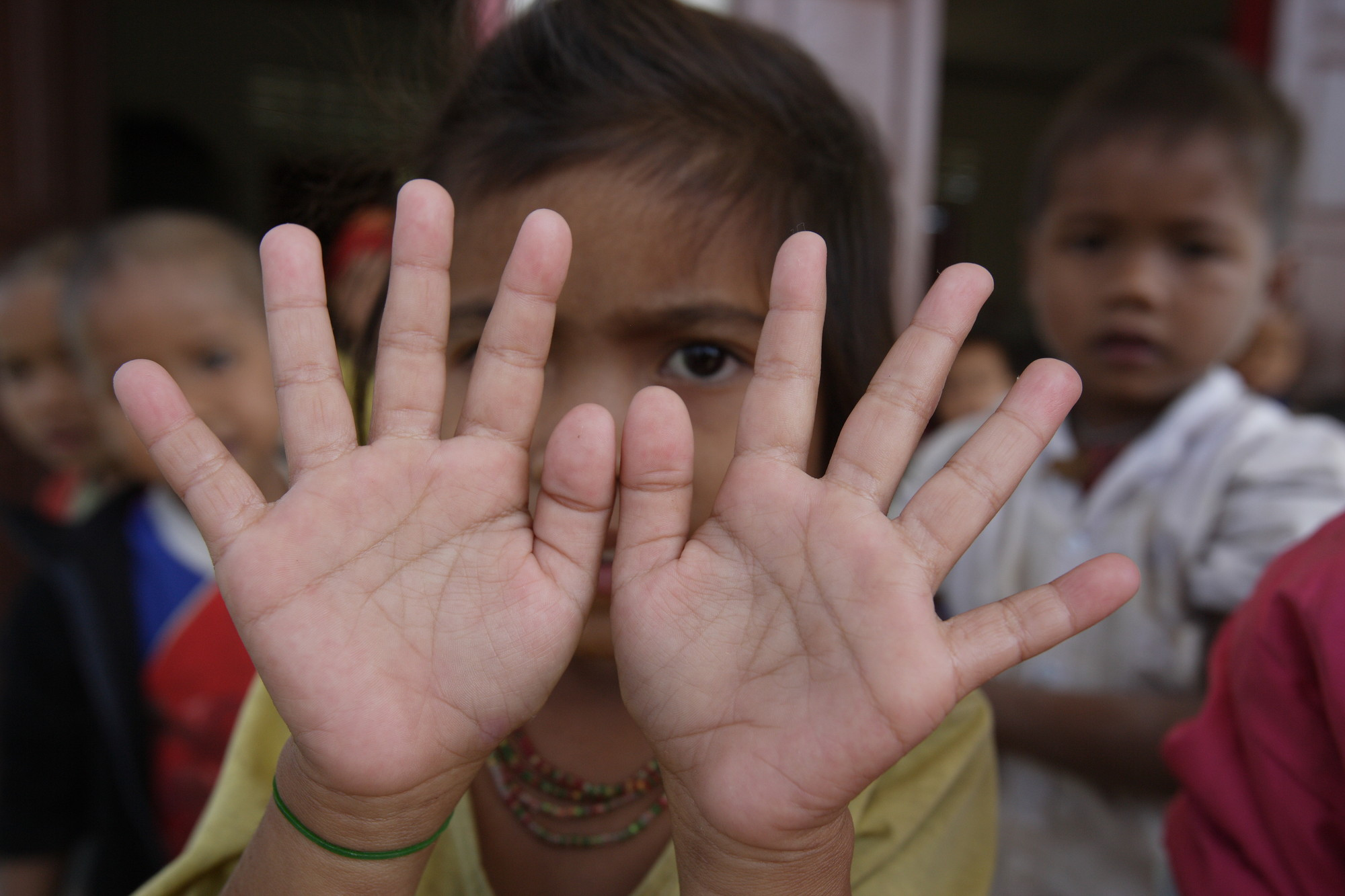 Young girls shows off her clean hands SAWRP project