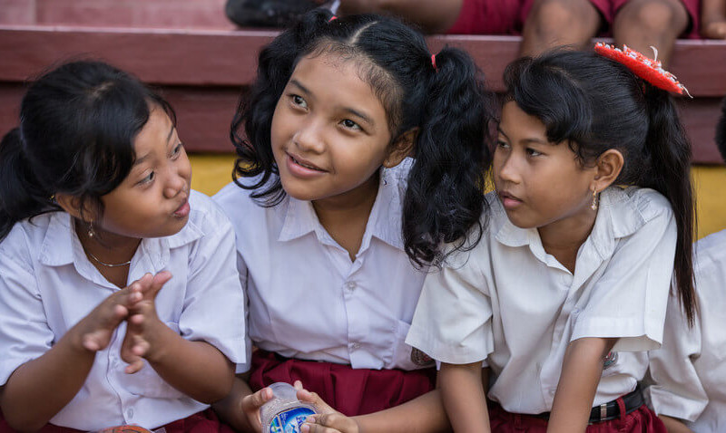 A special-needs student and her friends at their Plan-supported school in Indonesia