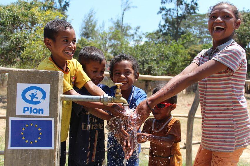 children-washing-hands-at-Plan-water-point