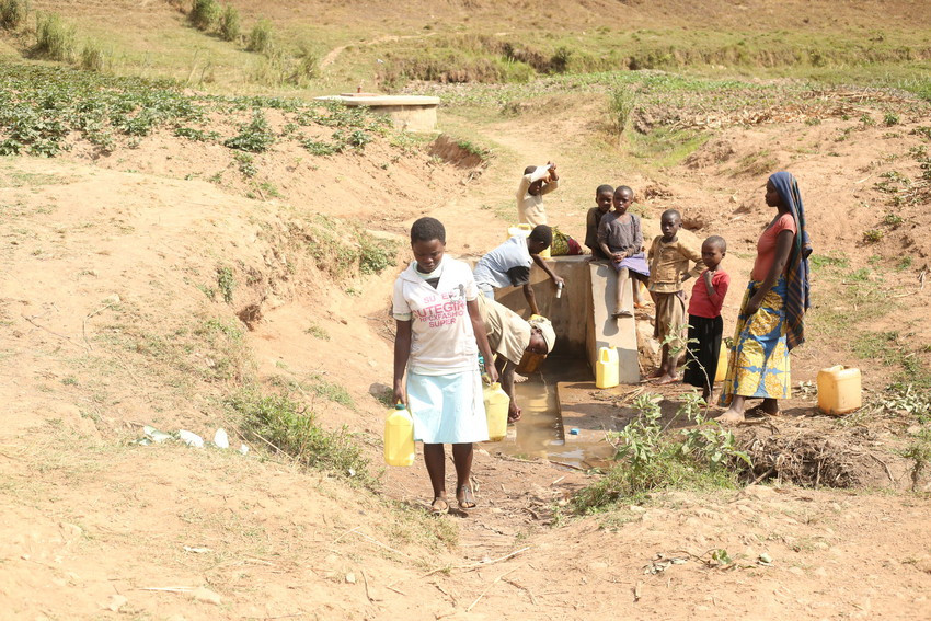 girl walking after collecting water