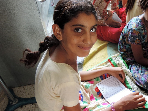 A girl learning at her Financial Education and Life Savings club in Bikaner, India