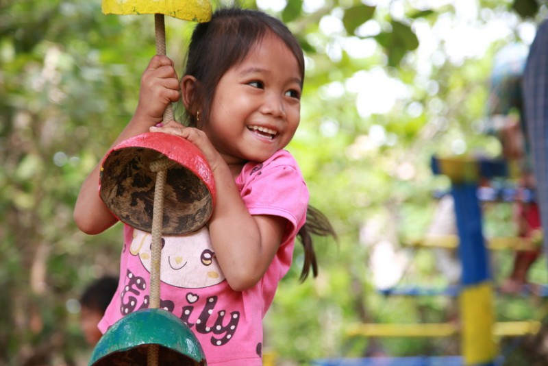A young girl playing at pre-school in Cambodia