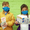 Photo of two children reading leaflets