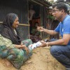 Azam, a WASH specialist, speaks with a resident in Cox's Bazar, Bangladesh