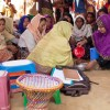 A hygiene awareness session takes place in one of the camps
