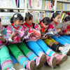 Girls read books at a school library
