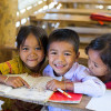 Children read books at their school in Laos