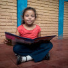 A girl reads a book in Nicaragua