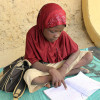 A girl reads a book in Niger