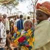 Burundi refugee mum holds her baby