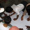 Children map out an evacuation plan