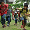 Children practice evacuating a school during a disaster drill