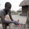 A girl washing her hands in a refugee settlement in Uganda