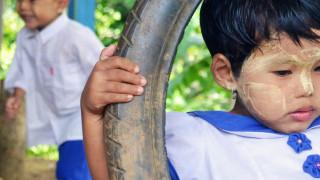 Girl plays on swings in Myanmar