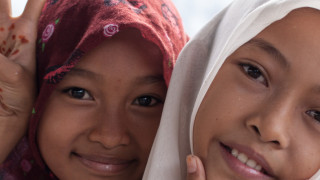 changing attitudes to girls. Girls from a local dance group in Aceh, Indonesia