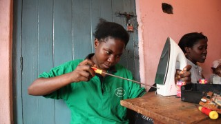 Grace fixing an iron, from exploitation to empowerment