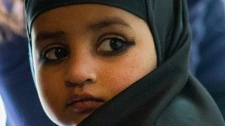 Young girl wearing head scarf at daycare centre in Delhi