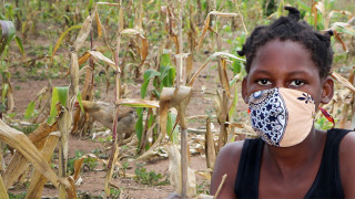 Photo of a girl wearing a mask in a field