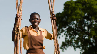 A girl carrying wood to her community in Ghana