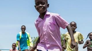 Juma playing football in Uganda