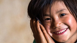 A girl smiles at school in Vietnam