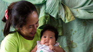 A mum and baby at a school which was been turned into an evacuation centre in the Philippines