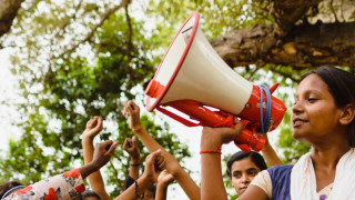 A girls with a megaphone in India