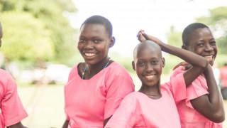Girls dance and smile in Uganda