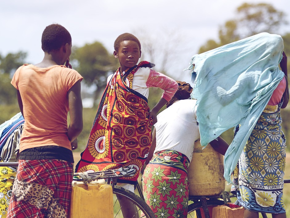 A group of girls in Kwale, Kenya fetch water in the mid-morning heat. Much of girls' study time is taken up by fetching water. Sometimes girls can only go to school for half-a-day, missing out on their lessons.